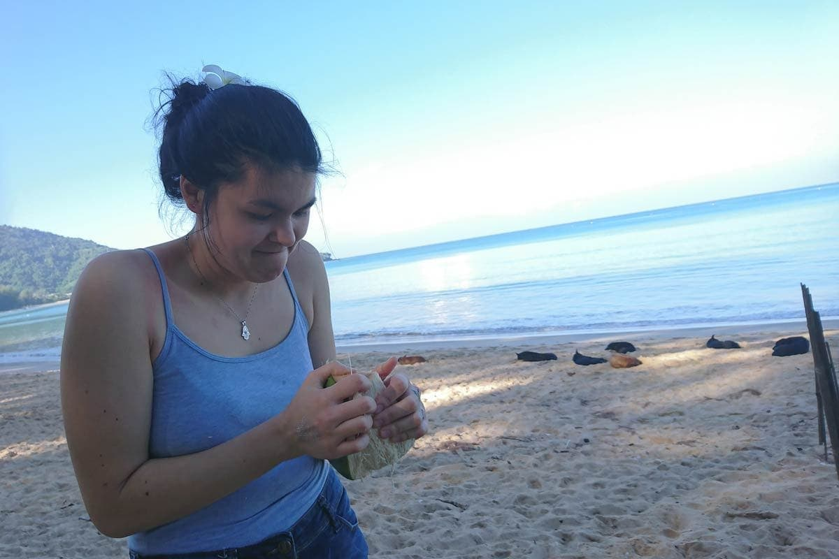 Jana fighting the coconut in Sirinat Phuket