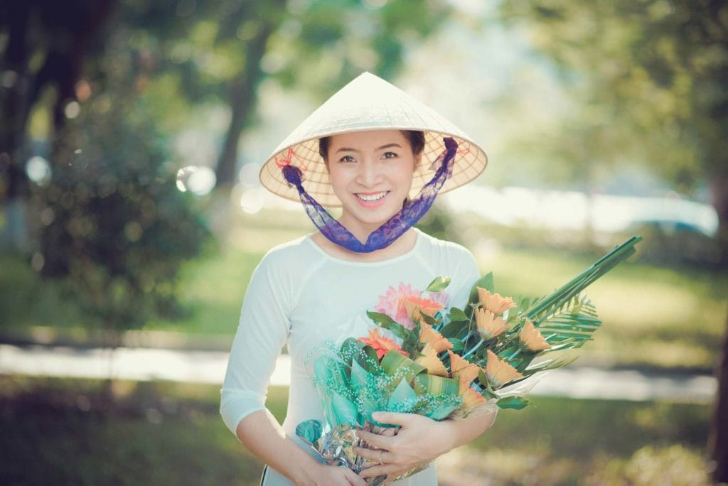 Beautiful Vietnamese Woman With Flowers South Vietnam