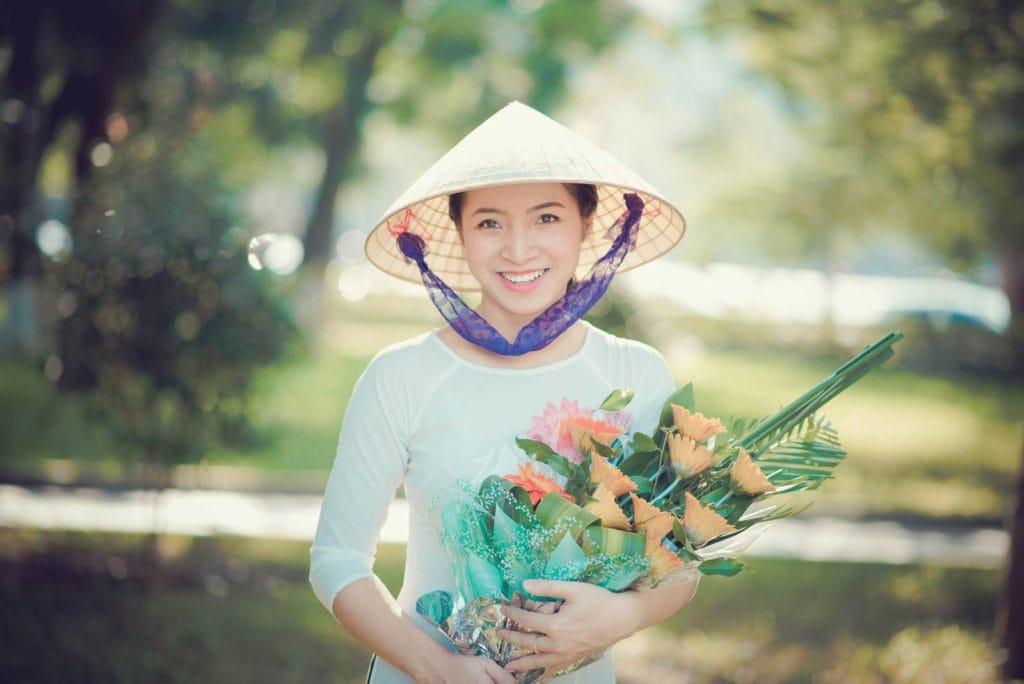 Beautiful Vietnamese Woman With Flowers South Vietnam